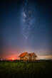 Landscape image of milky way over the abandoned twin house near Chalerm Phra Kiat road in Thale Noi, Phatthalung, Thailand
