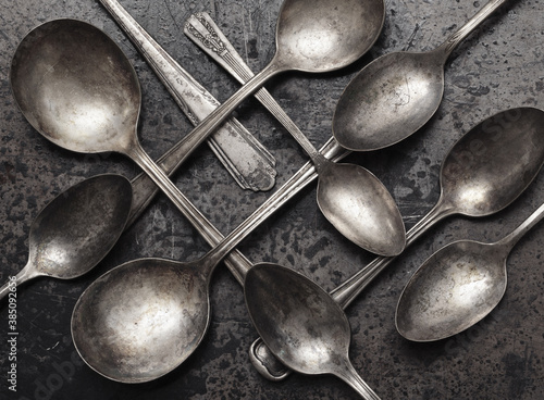 Old spoons on grungy surface Canvas