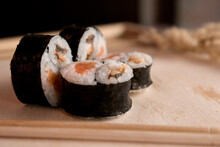 Sushi Is One Of The National Dishes Of Japan, Which Is Very Popular All Over The World Presented On A Wooden Tray
