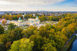 Autumn in Wilanow palace garden, Warsaw distant city center aerial view in the background