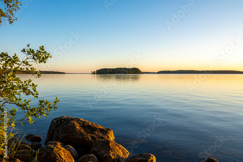 Obraz View of the sunset on The Lake Saimaa, Lammassaari, Imatra, Finland - fototapety do salonu