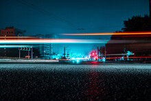 Night View Of A Road With Cars. Light Trails On A Long Exposure.