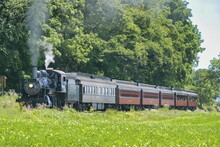 Restored Antique Steam Locomotive With Passenger Cars