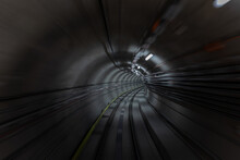Construction Site Of The Subway Tunnel With Blurred Light Tracks. Underground Facility Leading Deep Down.