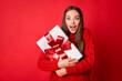 Leinwandbild Motiv Photo of girl hug x-mas christmas gift box feel impressed wear sweater pullover isolated over bright shine color background