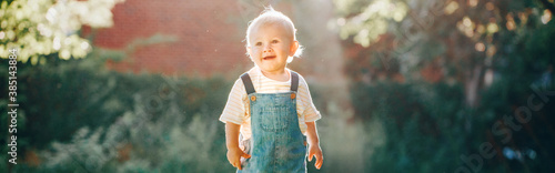 Fototapeta Cute baby boy in park at sunset outdoors