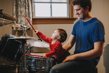 Father Teaching Baby Boy To Play Drums, Parent With Toddler Child Having Fun And Spending Time Together, Dad And Kid Playing Music, Family Hobby Activity, Leisure Time, Fathers Day,