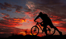 Cyclist With A Bicycle, In The...