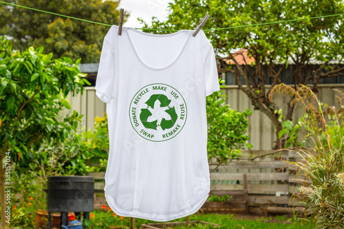 Obraz T shirt on washing line with circular economy textiles icon, make, use, reuse, swap, donate, recycle with eco clothes recycle icon sustainable fashion concept - fototapety do salonu