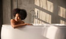 Woman Taking A Bath Alone In T...
