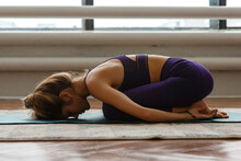 Flexible Woman Stretching In P...