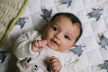 Baby On White Blanket