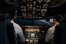 Pilots In Aircraft Cockpit Con...