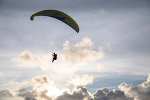 A Paraglider Flies High Above ...