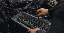 Crop Man Fixing Engine Of Brok...
