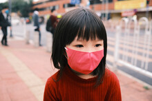 Little Girl Wearing A Mask