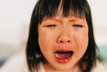 Asian Little Girl Crying With Tears In Her Face