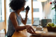Young Woman Having Breakfast O...