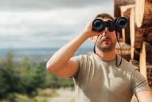 Male Hiker Looking Through Bin...