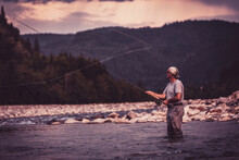 Fly Fisherman Casting With Fis...