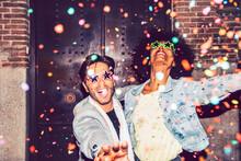 Confetti Falling On Cheerful C...