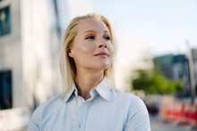 Confident Businesswoman Looking Away At Financial District In City