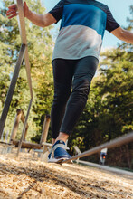 Man Balancing On Rope On A Fitness Trail