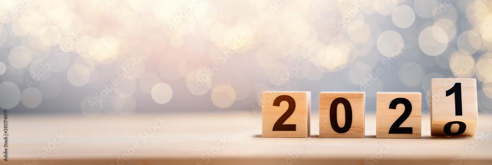 Fototapeta Wooden Blocks With 2020 2021 Number On Table