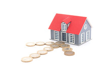 Arrow Sign Made Of Euro Coins On White Background Points To House Model
