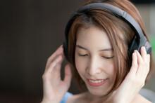 Woman Listens Music Wearing An...