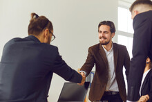 Businessman Shakes Hands With ...