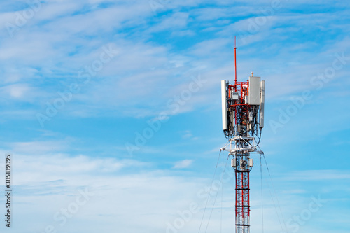Fotografie, Obraz Telecommunication tower with blue sky and white clouds background