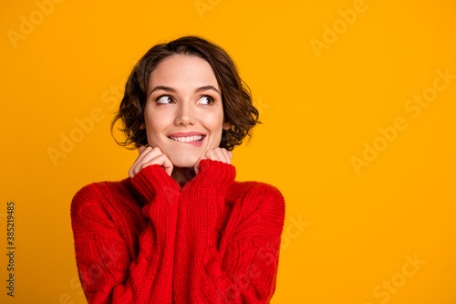 Photo of overjoyed lady dreamer look up empty space enjoy cloth warmth winter holidays think of celebrating family meeting gathering wear red knitted sweater isolated yellow color background