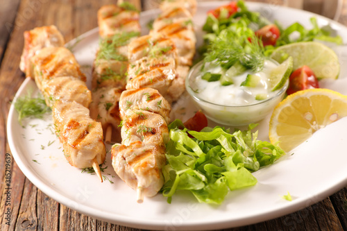 Fototapeta grilled chicken skewer with sauce and lettuce