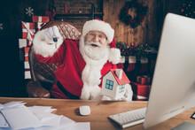 X-mas Christmas Lottery Insurance House Win Concept. Grey White Hair Beard Santa Claus Sit Table Show Keys Wear Cap Headwear Lapland Flat Indoors Noel Spirit Advent Atmosphere Ornament