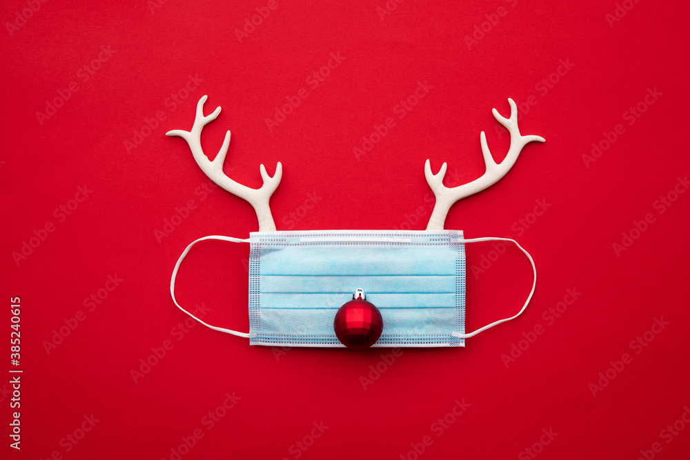 Fototapeta Festive christmas reindeer made from face mask and decorations
