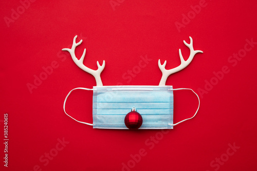 Festive christmas reindeer made from face mask and decorations - 385240615