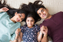 Portrait Of Happy Asian Indian Young Family. Mother, Father Daughters And Son