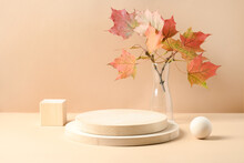Stands For Product Of Wooden Materials. Cube, Ball And Plate As Podium. Composition With Autumn Leaves On Beige Background.