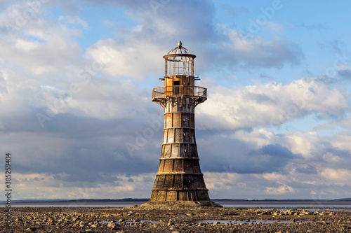 Fotografiet Whiteford Lighthouse is listed by Cadw as Grade II* A wave-swept cast-iron lighthouse in British coastal waters and an important work of cast-iron engineering and nineteenth-century architecture