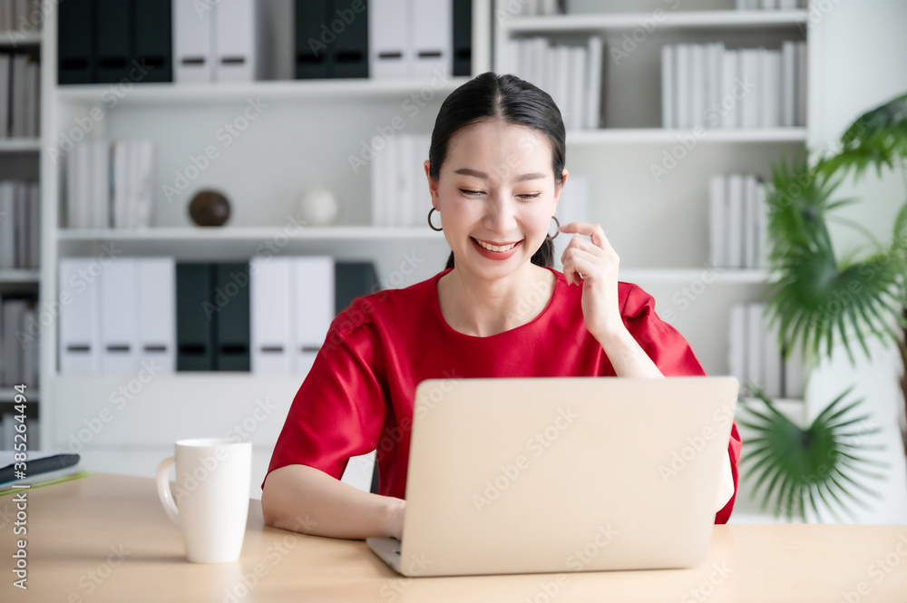 Fototapeta Work from home concept, Portrait of beautiful young asian woman working on laptop in workplace