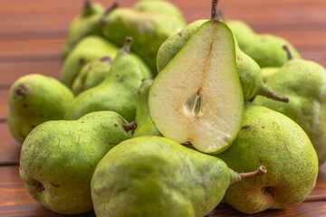 Bio sweet fresh pears from the farm. Healthy Organic Pears in the Basket on wooden rustic background. Healthy food full of vitamins. Pear harvest.Autumn nature concept. Tasty vegetarian snack.