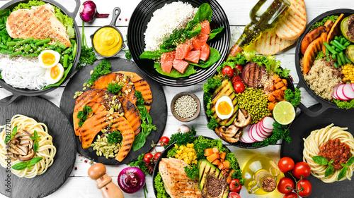 Fotografie, Obraz Set of food in plates: pasta, chicken, meat, mushrooms