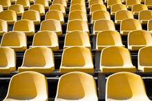 Empty Yellow Seats On Outdoor ...