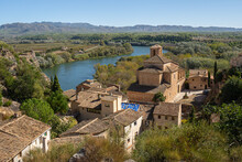 The Ebro River And The Old Town Of Miravet, Tarragona Province In Spain.