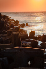 Concrete Wave Breaker With The North Sea Ocean In The Background With Colorful Sunset Light, Denmark