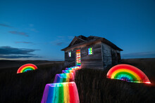 Light Painted Rainbows Around An Abandoned Building