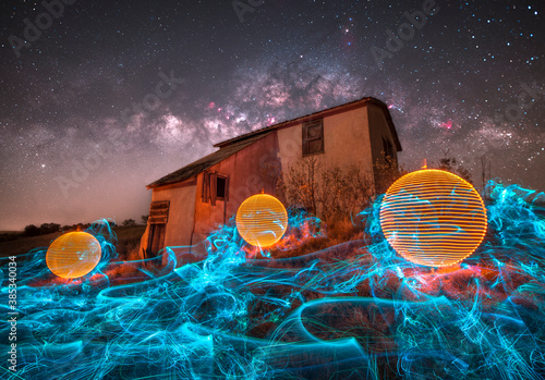 Cuadros en Lienzo Light Painted Orbs Around an Abandoned Building, Long Exposure Photography