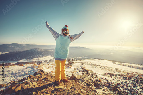 Woman standing on the top, admiring winter mountain landscape Canvas Print