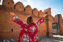 Asian Woman Traveling At Tha Phae Chiangmai Old City Wall In Northern Thailand